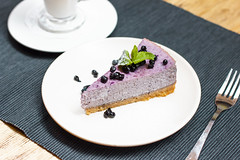 Blueberry cheesecake with berries and mint with coffee latte on the table (Galina Zhigalova) Tags: cheesecake blueberry coffee top cake plate delicious dessert food hot sweet view bakery cup cheese drink tasty snack gourmet eating sugar pie slice fork blue cappuccino fresh freshness cut restaurant cream taste berry baked yummy latte tart spoon table cafe cafeteria mint