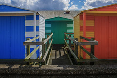 17 6 18 (lowooley.) Tags: whitstable kent southeastengland beachhuts blue green orange fence