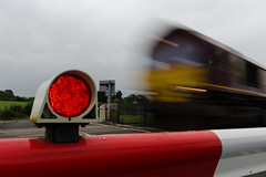 Shed blur (mikeplonk) Tags: blur blurredtrain blurred motion movement movingtrain pontsarn levelcrossing barrier light redlight red white wales southwales greatwesternmainline class66 shed dbc dbcargo nikon d5100 18140mm kitlens
