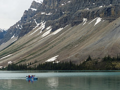 Bow Lake (annkelliott) Tags: alberta canada icefieldsparkway bowlake nature scenery landscape lake water mountain scree slope rock erosion beauty kayak people two recreation outdoor summer 23june2018 fz200 fz2004 panasonic lumix annkelliott anneelliott ©anneelliott2018 ©allrightsreserved