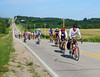 Long line of riders up a long hill