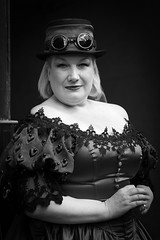 Portrait from the Whitby Steampunk Weekend IV - Days Like These (Gordon.A) Tags: yorkshire whitby steampunk whitbysteampunkweekend iv dayslikethese wsw july 2018 convivial goth gothic whitbygoths creative hat goggles culture lifestyle style fashion street festival event eventphotography outdoor outdoors outside amateur streetphotography pose posed portrait streetportrait blackandwhite bnw bw mono monochrome monochromatic naturallight naturallightportrait digital canon eos 750d sigma sigma50100mmf18dc