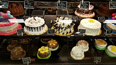 Cake (Studio d'Xavier) Tags: werehere storesnapshotssneakilyphotographingcommerce cake brown grocerystore supermarket
