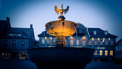 The Holy Grail (dlerps) Tags: city daniellerps deutschland europe fountain germany goslar harz lerps mitteldeutschland norddeutschland northerngermany sigma sony sonyalpha sonyalpha77 sonyalphaa77 twilight urban lerpsphotography niedersachsen de blue bluehour gold water yellow evening civiltwilight nauticaltwilight night longexposure lights light marketsquare lowersaxony
