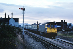 In almost as dismal conditions Slim Jim whisks it's train south along the North & West. 33207 still operable today with West Coast Railways....1V09 33207 14-08 Holyhead-Cardiff Brimfield nr Ludlow 27-09-1986 (the.chair) Tags: 1v09 33207 1408 holyheadcardiff brimfield n w sept 1986