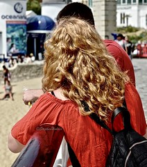 InTheRed (Hodd1350) Tags: bournemouth bournemouthpier dorset back redhead red backpack talking man male woman female beach leica leicaq