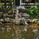 Pond and sculpture int the garden of Erawan museum in Samut Phrakan province near Bangkok, Thailand thumbnail
