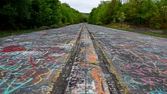 Graffiti Highway, facing north (SchuminWeb) Tags: schuminweb ben schumin web may 2018 centralia columbia county pennsylvania pa graffiti highway state route 61 route61 graffitihighway abandoned road roads highways high way ways urban exploration urbex roadway roadways ghost town ghosttown alignment alignments coal mine fire towns spray paint spraypaint paints spraypaints tag tags tagged tagging infrastructure infrastructural infra structure structural