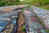 Rift in the former Route 61 (SchuminWeb) Tags: schuminweb ben schumin web may 2018 centralia columbia county pennsylvania pa graffiti highway state route 61 route61 graffitihighway abandoned road roads highways high way ways urban exploration urbex roadway roadways ghost town ghosttown alignment alignments coal mine fire towns spray paint spraypaint paints spraypaints tag tags tagged tagging infrastructure infrastructural infra structure structural ground subsidence cracking crack cracks cracked separating separate separation separated rifting rifts rifted