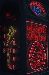 Adult Video (Jam-Gloom) Tags: olympusuk olympus olympusomd olympusomdem5 omdem5 omd em5 panaleica panaleica25mm panaleica25mm14 panasonicleicasummilux25mm14 panasonic leica summilux 25mm 14 25mm14 street streetphoto streetphotography soho london windowdisplay peepshow neon neons adultvideo girlsgirlsgirls eye