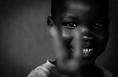 Boy from Gulu (gunnisal) Tags: african portrait child face eyes smile bw blackandwhite monochrome gunnisal uganda gulu