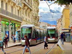 A Slice of a Day in Grenoble, France (Haytham M.) Tags: sky rain clouds spring sliceoflife oflife slice historic city france grenoble targetmoi pedestrians walk street tram