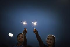 (Rebecca812) Tags: girl children fourthofjuly independenceday usa night sparkler celebration lookingup selectivefocus canon people girlpower portrait