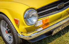 Triumph TR6. (Tony Smith Photo's) Tags: badge britain british chrome classiccar closeup color design detail fast historic iconic isolated motor road shiny speed tire triumph triumphtr6 tyre wheel yellow antique auto automobile automotive beautiful bumper car classic colorful drive elegant front grill headlamp headlight historical history icon indicator lamp light nostalgia nostalgic old polished retro revival roadster seventees sleek sports sportscar style technology transport transportation travel vehicle vintage vintagecar wheels
