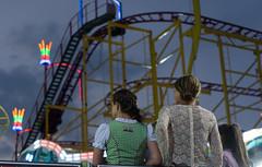 Roller coaster (gerhardschorsch) Tags: sony nightshot night ilce7r a7r available availablelight 55mm fe55mmf18za fe55mm zeiss za girls hair haare roller coaster achterbahn volksfest light licht urban unschärfe tracht sommer