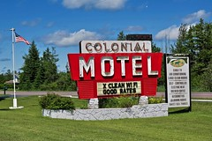 Colonial Motel, Manistique, MI (Robby Virus) Tags: manistique michigan mi up upper peninsula colonial motel neon sign signage american flag good rates