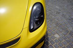 Cayman GT4 in detail (Eric Flexyourhead) Tags: minato minatoku 港区 osaka osakashi 大阪市 kansai 関西地方 japan 日本 museum carmuseum glionmuseum car german detail fragment porsche cayman gt4 caymangt4 porschecaymangt4 headlights headlamps yellow bright vibrant vivid sonyalphaa7 zeisssonnartfe35mmf28za zeiss 35mmf28