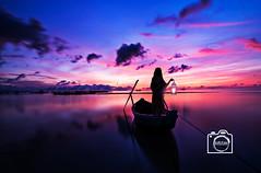 Alone in the dusk (DJR-FOTO) Tags: woman girl boat lantern laterne boot frau mädchen lila meer sea purple sky himmel wolken clouds spiegelreflex reflections nature natur affinityphoto manipulation eos colours dof