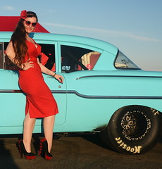 Holly_9233 (Fast an' Bulbous) Tags: classic american car vehicle chevy automobile girl woman hot sexy pinup model long brunette hair red wiggle dress high heels stockings nylons people outdoor sky santa pod