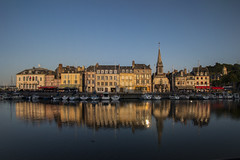 "late afternoon summer sun paints a sumptuous, glowing, picture of Quai Saint Etienne. Honfleur, Calvados, Normandy, France (grumpybaldprof) Tags: honfleur normandy normandie france calvados ""vieuxbassin"" ""oldharbour"" ""quaistecatherine"" ""quaiquarantaine"" quai ""quaistetienne"" ""stecatherine"" ""lalieutenance"" quarantaine water boats sails ships harbour historic old ancient monument picturesque restaurants bars town port colour lights reflection architecture buildings mooring sailing stone collombage halftimbered yachts carousel merrygoround reflections ""waterreflections ""wetreflections"" funfair ""eglisesaintecatherine"" ""églisesaintétienne"" yacht voillier canon 70d ""canon70d"" tamron 16300 16300mm ""tamron16300mmf3563diiivcpzdb016"" glow solour wetreflections light warm artistic wellcoming mood atmosphere fineart"
