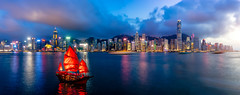 Panorama of Hong Kong City skyline with tourist sailboat at night. View from across Victoria Harbor HongKong. (MongkolChuewong) Tags: architecture asia background beautiful blue boat building business china chinese city cityscape cruise downtown harbor harbour hong hongkong island junk kong landmark landscape modern night ocean panorama port red sail sailboat sea ship sightseeing skyline skyscraper sunset tour tourism tourist tower traditional transportation travel vacation vessel victoria view water wooden