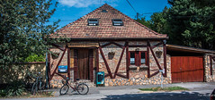 2018 - Hungary - Mohács - Kazinczy Söröző (Ted's photos - For Me & You) Tags: 2018 cropped hungary mohács nikon nikond750 nikonfx tedmcgrath tedsphotos vignetting mohácshungary house bicycle bike streetscene street brick trees shadow shadows bluesky blue kazinczysöröző kazinczystreet kazinczystreetmohacs doors windows doorsandwindows