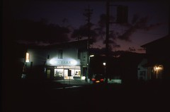 (✞bens▲n) Tags: leica m4 velvia 50 summilux 50mm f14 film analogue slide dark japan nagano drug store building sky landscape road car