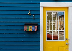 41 (Karen_Chappell) Tags: jellybeanrow rowhouse house mailbox post mail 41 number wood wooden paint painted door yellow blue white trim reflection reflections stjohns downtown city urban architecture glass window green red orange multicoloured colourful colours colour color canada eastcoast avalonpeninsula atlanticcanada nfld newfoundland clapboard