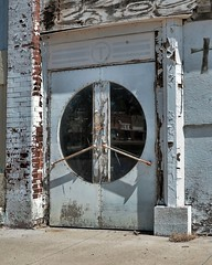 Reflecting on Yates (Rusty Karr) Tags: kansas old small town architecture outdoors