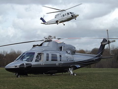 G-URSA Sikorsky S-76C (Capital Air Services Ltd PremiAir Aviation Services Ltd) With M-JCBC Sikorsky S-76C (J C Bamford Excavators Ltd) Two Helicopters (Aircaft @ Gloucestershire Airport By James) Tags: cheltenham helipad gursa sikorsky s76c capital air services ltd premiair aviation with mjcbc j c bamford excavators two helicopters egbc james lloyds