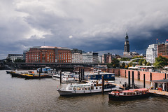Hamburg (LucasRebmannPhotography) Tags: hamburg germany clouds wolken deutschland fujifilm xt20 x t 20 2018 street city trees cars autos building haus häuser strase shadow schatten phone architecture water sky himmel blue blau rain summer sommer light 23mm 14 f14 lens xf23mmf14 r lamp bridge church churchtower kirche opera river bokeh reflection iso 200 day sun