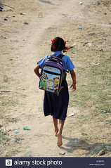 a-student-of-the-girls-school-in-mundia-walks-barefoot-to-schoolin-D1BFFK (Matriux2011) Tags: barefoot dirtysoles cracksoles indian nepali barefootextreme talonescurtidos piesrajados