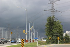 2018 08 17_9655 (djp3000) Tags: clouds storm trafficlights electricitypylons pylons lampposts streetlamps greysky blackclouds roadsigns