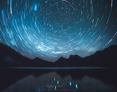 Dove Lake, Cradle Mountain and a Million Stars (Santanu Banik) Tags: dovelake cradlemountain cradlemountainlakestclairnationalpark nationalpark tasmania tassie night calm water still reflection tranquil australia startrail astro astrophotography midnight trails iconic