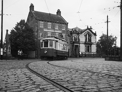 Tram in Beamish Museum town (Hammerhead27) Tags: tramway cobbles oldstyle bank building vintage historic retro old town bw blackandwhite mono monochrome england countydurham museum beamish rail track tram