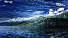 Lightplay (Alfred Grupstra) Tags: nature mountain lake landscape water scenics fjord outdoors summer norway beautyinnature blue mountainrange europe sky cloudsky reflection europeanalps sea rockobject ohrid macedonia