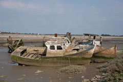 boat cemetery (Istvan SZEKANY) Tags: continentsetpays europe fr fra france paysdelaloire abandonnedships atlanticocean blue bluesky boatcemetery boats discovery ecology fishingboats noirmoutierenlîle ocean ride ships trip vessels wrecks