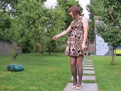 Lawnmower alarm (Paula Satijn) Tags: girl skirt chic elegant classy happy fun joy outside garden orchard smile lady sweet legs sexy hot heels pumps stockings dress cocktaildress partydress tgirl tranny transvestite trees