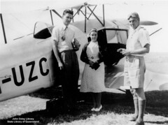 Two doctors and a nurse standing next to a plane, 1939. (State Library of Queensland, Australia) Tags: queensland statelibraryofqueensland doctors doctor medicine nurse royalflyingdoctorservice aeroplane biplane goggles nurses vhuzc cn4048 4048 gaccu qantasempireairways qea royalaustralianairforce raaf raafa414 a414 airambulance flyingambulance aviation aircraft airplane dehavilland dehavillanddh83foxmoth dehavillanddh83 dehavillandfoxmoth dh83foxmoth dh83 foxmoth dehavillandgipsy dehavillandgipsyiii gipsyiii