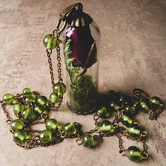 Half of my new handmade rose bell jar necklaces sold last night, so if you really like this particular style which uses the last of my green glass vintage chain, there are only three left. They are available on my website at the top of the page.✨ (BlackBaccara) Tags: perfume art beauty fragrance indie goth perfumeoils conceptual