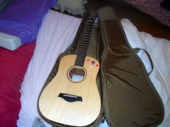 DSC00054 (classroomcamera) Tags: guitar guitars music musical play plays playing strum strums strumming acoustic acoustics case cases brown wood wooden black green olive white blue red pillow pillows blanket blankets lay lays laying ready
