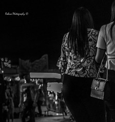 Stepping out tonight (Robica Photography) Tags: robicaphotography d3200 2018 streetphotography straatfotografie tilburg people face evening lights attraction funfair fair amusement detilburgsekermis women walking purse blackandwhite bnw bw