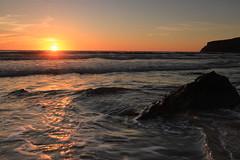 A calm Night (joerusson) Tags: peaceful landscape photography sunset seascape beach starburst rocks waves calm canon