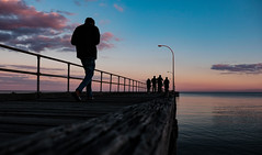 Man on Pier (Leon Sammartino) Tags: pier man sunset golden hour wide fujifilm walk portrait australia victoria altona