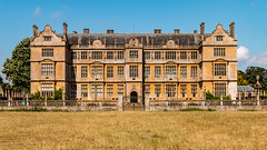 Montacute House (Keith in Exeter) Tags: montacute house mansion building architecture nationaltrust somerset window chimney sandstone wall balustrade gate entrance field grass tree sky