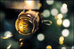 Let it fizz! (G. Postlethwaite esq.) Tags: dof fujx100t bokeh bottle celebration champagne closeup cork fizz photoborder poshlager promotion reflection selectivefocus
