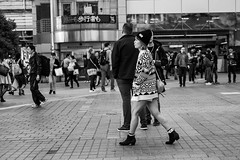 Cold Legs, Warm Heart (burnt dirt) Tags: asian japan tokyo shibuya station streetphotography documentary candid portrait fujifilm xt1 bw blackandwhite laugh smile cute sexy latina young girl woman japanese korean thai dress skirt shorts jeans jacket leather pants boots heels stilettos bra stockings tights yogapants leggings couple lovers friends longhair shorthair ponytail cellphone glasses sunglasses blonde brunette redhead tattoo model train bus busstation metro city town downtown sidewalk pretty beautiful selfie fashion pregnant sweater people person costume cosplay boobs