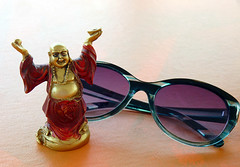 Tiny Buddha ~ Healed (Rain Love AMR) Tags: tinybuddha glasses sunglasses orange purple red gold buddha small figurine statue laughing spiritual