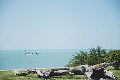 Drifting (Laughing Dogs) Tags: boat ocean water driftwood statepark fortzacharytaylor fortzach fort floridakeys keywest keys florida