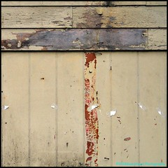 Loosing My (Traditional) Religion (Beachhead Photography) Tags: beachheadphotography wood wall broken paper paint flakingpaint peelingpaint nails staples lines building boards bent